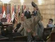 Iraqi Jaournalist attacked  bush with shoes  powerpoint presentation